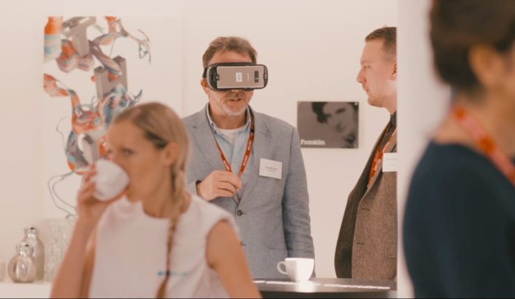 Man at techshare pro 2017 with an Augmented Reality headset on