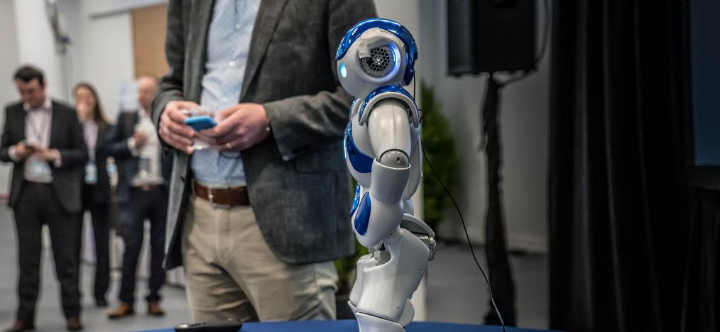 man showcasing small robot