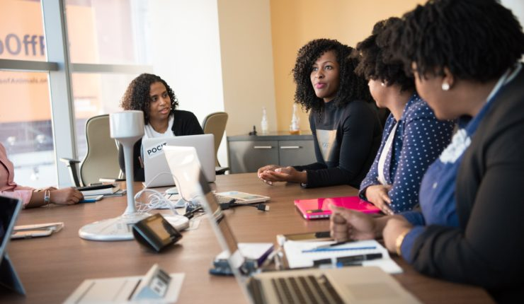 4 women talking round a table